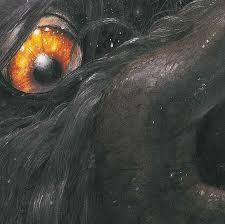 legende chien noir gros plan